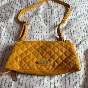 Yellow crossbody purse.